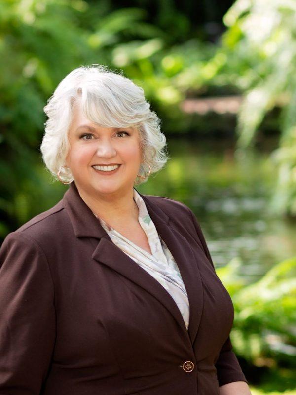 Attorney Theresa Beran Kulat Standing in Garfield Park Conservatory