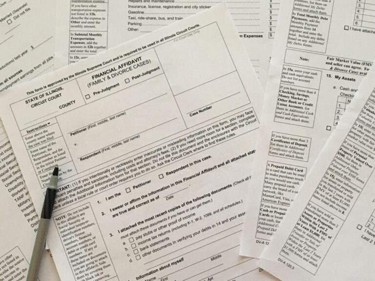 Closeup of selected pages of the Illinois Financial Affidavit and ink pen